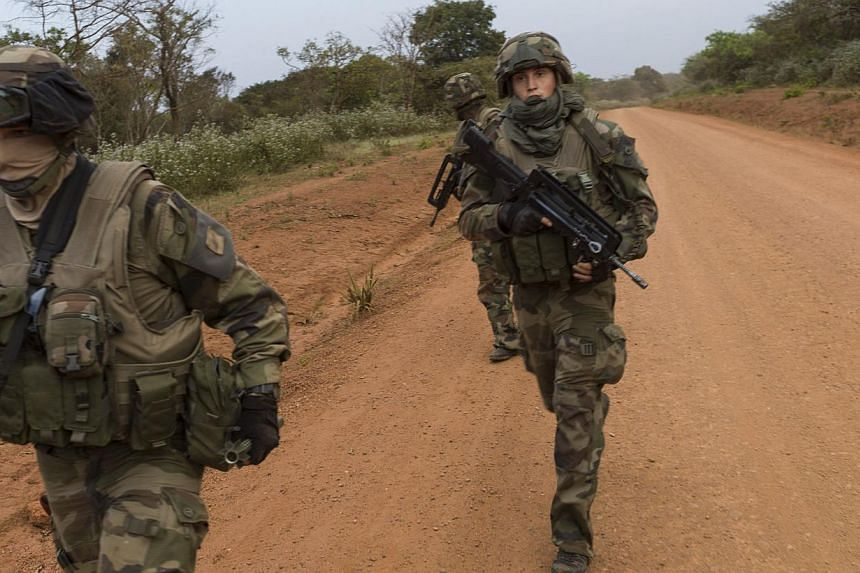 French soldiers patrolling a road in Baoro on Dec 7, 2013, as part of the military operation aiming at restoring security in simmering Central African Republic. The troops received a triumphant welcome as they deployed in strife-torn country, while t