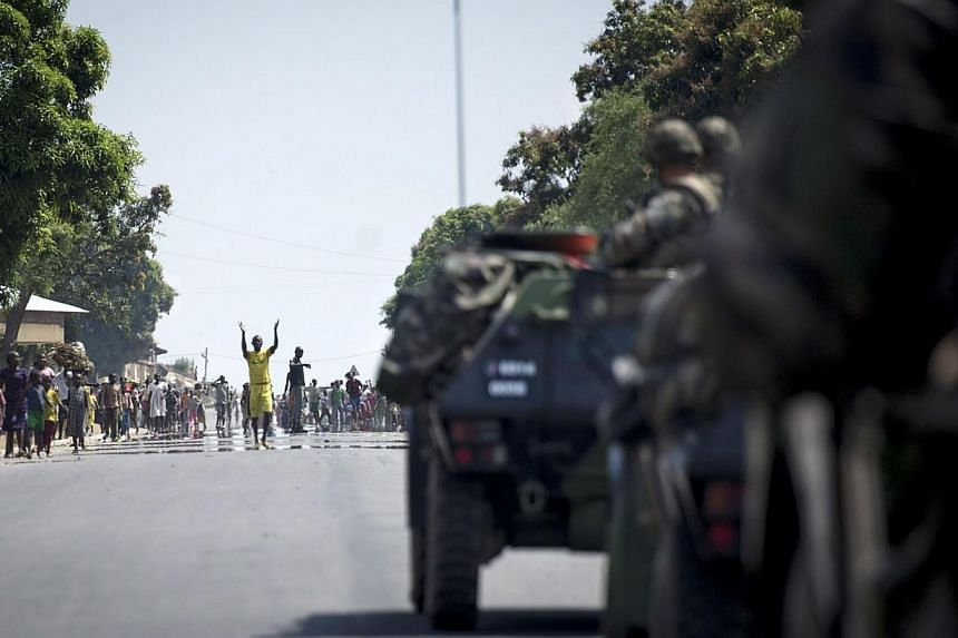 People from Bouar welcoming the French military arriving from Cameroon on Dec 7, 2013. The troops received a triumphant welcome as they deployed in strife-torn Central African Republic, while the African Union said it would nearly double its force in