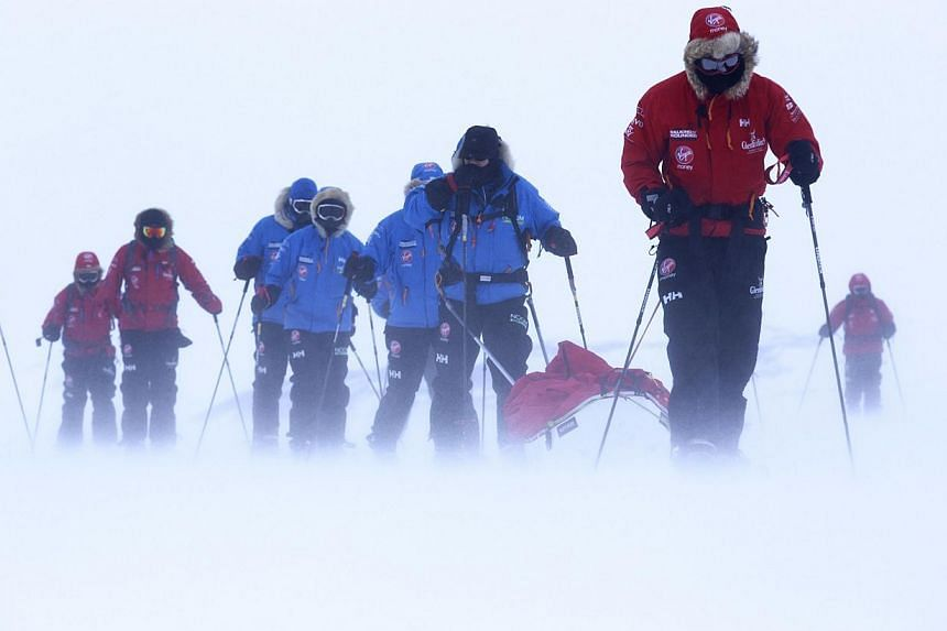 This undated photo made available by Walking with the Wounded (WWTW) on Saturday Dec. 7, 2013 shows Britain's Prince Harry, right, during training near Novo, Antarctica, ahead of an Antarctic charity race.A race to the South Pole involving Brit