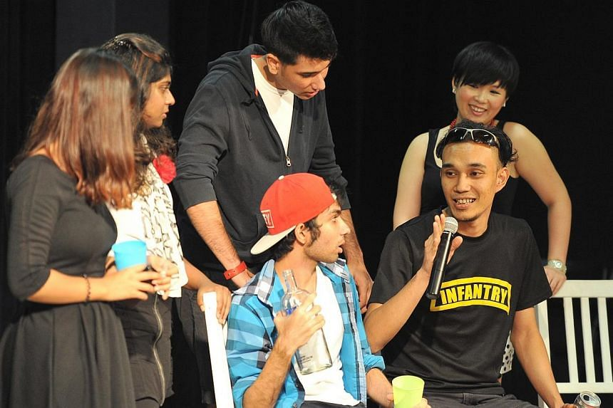 Mr Muhammad Luqman Hakim, (right) 24, Barista, is an audience taking part in the Just A Bad Day: Forum Theatre at Aliwal Arts Centre on Sunday, Dec 08, 2013.The play led to a violent outcome and the audience got to change the outcome of the pla