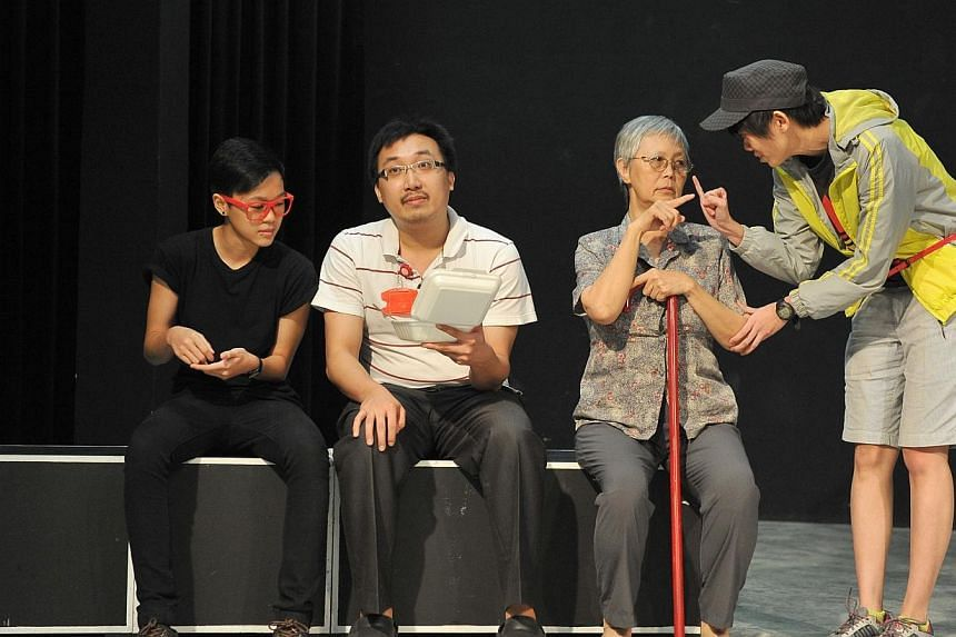 Ms Tan Jia Yee, (right) 23, student, is an audience taking part in the Just A Bad Day: Forum Theatre at Aliwal Arts Centre on Sunday, Dec 08, 2013.The play led to a violent outcome and the audience got to change the outcome of the play by actin