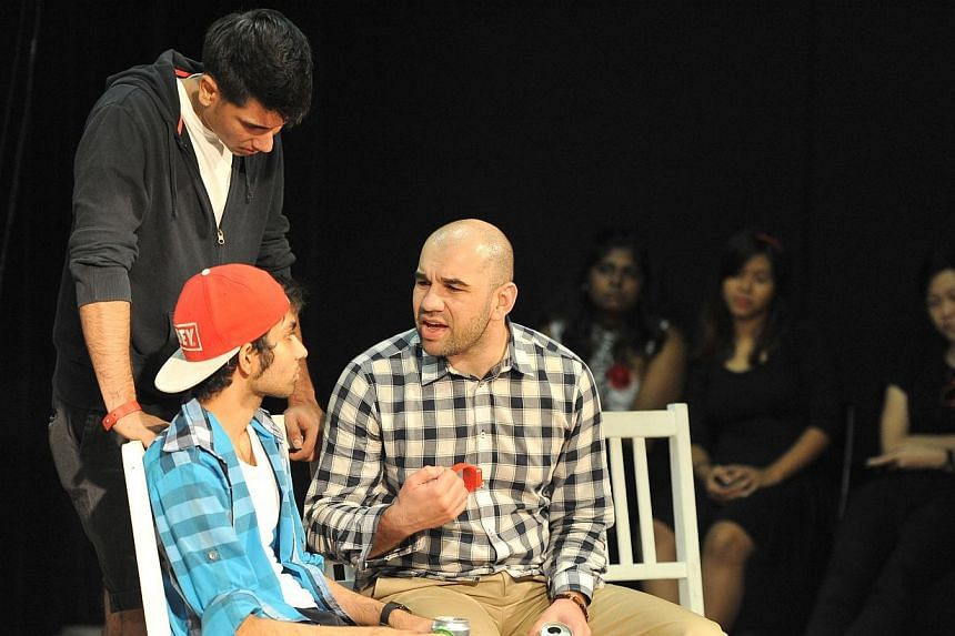 Associate Professor Kurtulus Gemici, (right) 37, an audience, taking part in the Just A Bad Day: Forum Theatre at Aliwal Arts Centreon Sunday, Dec 08, 2013. The play led to a violent outcome and the audience got to change the outcome of the pla