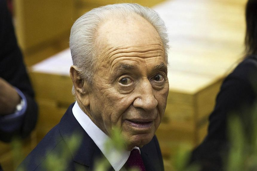 Israeli President Shimon Peres, arrives at the International Book Fair in Guadalajara, Mexico, on Nov 30, 2013.Mr Peres said Sunday he would be prepared to meet his Iranian counterpart Hassan Rouhani, even though their two countries consider ea