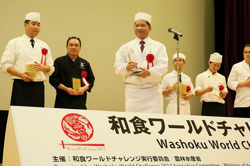 Singaporean chef Li Kwok Wing (centre), popularly known as Santaro, beat nine other chefs from around the world to win the inaugural Washoku World Challenge in Tokyo yesterday. Behind him in black is Singaporean chef Mark Tay Kuan Jin, who was also a