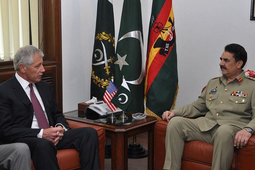 In this handout photograph released by Pakistan's Inter Services Public Relations (ISPR) on Monday, Dec 9, 2013, Pakistan's army chief General Raheel Sharif (right) meets with US defence secretary Chuck Hagel at the General Headquarters in Rawalpindi
