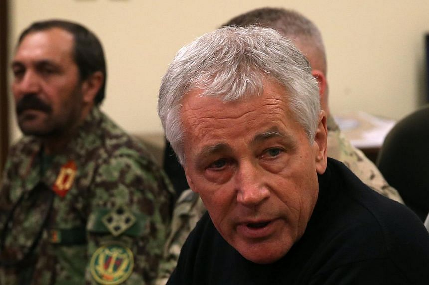 US Secretary of Defense Chuck Hagel (right) speaks during a meeting with Afghan military leaders in Kandahar, Afghanistan on Sunday, Dec 8, 2013. Mr Hagelwarned Pakistani leaders on Monday, Dec 9, 2013, that if they do not resolve protests stal