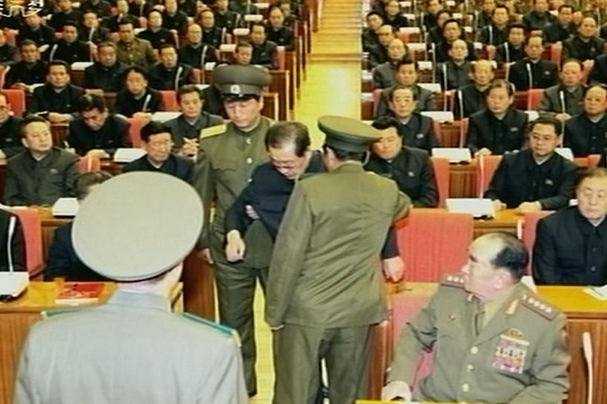 A still image taken from North Korea's state-run KRT television footage and released by Yonhap on Monday, Dec 9, 2013, shows Jang Song Thaek being forcibly removed by uniformed personnel from a meeting of the Political Bureau of the Central Committee