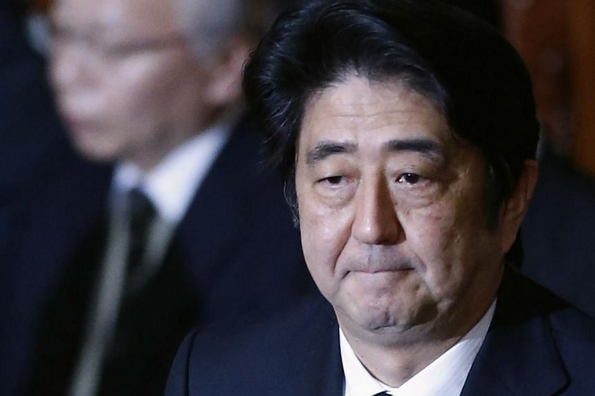 Japan's Prime Minister Shinzo Abe attends at the plenary session of the Lower House of the parliament as it rejects a no-confidence resolution against the Cabinet, in Tokyo, on Dec 6, 2013. Support for Japanese Prime Minister Shinzo Abe slid in opini
