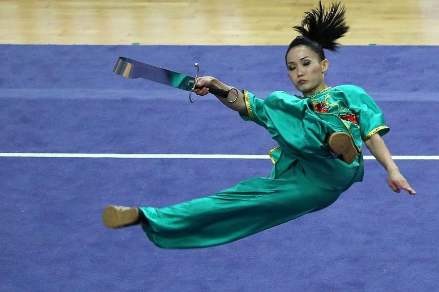 Malaysia's Diana Bong Siong Lin performs during the women's Nandao competition during the 27th SEA Games in Nay Pyi Daw, Dec 8, 2013.
