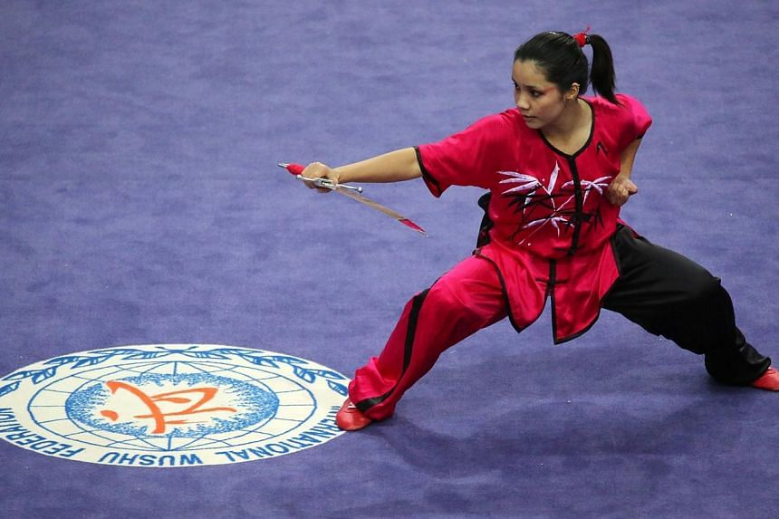 Min Li Emily Sin of Singapore performs during the women's Nandao competition during the 27th SEA Games in Nay Pyi Daw, on Dec 8, 2013. There were no more medals from Singapore's Wushu athletes on Monday, Dec 9, 2013, a day after they clinched a silve