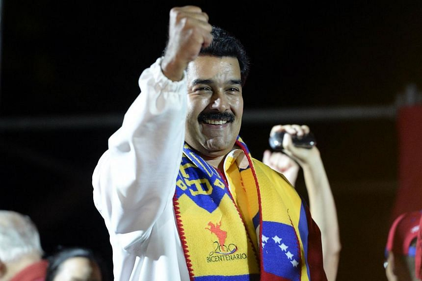 Venezuelan President Nicolas Maduro delivering a speech after the first official results in the country's municipal elections were announced in Caracas on Dec 8, 2013. The Presidentweathered Venezuela's mayoral elections, winning the biggest sh