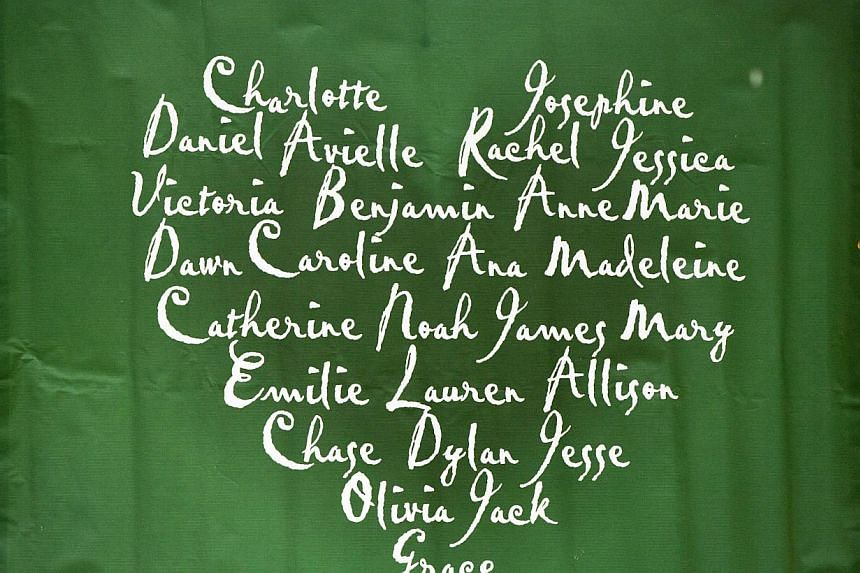 A banner bearing the names of the victims killed in the Sandy Hook Elementary School tragedy in Newtown, Connecticut hangs before family members arrive to give a statement about the formation of the website Mysandyhookfamily.org just before the one y