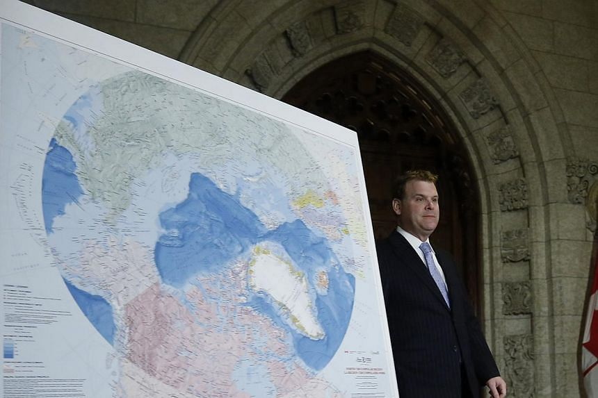 Canada's Foreign Minister John Baird arriving at a news conference next to a map of the Artic on Parliament Hill in Ottawa on December 9, 2013. Canada intends to lay claim to the North Pole as part of a bid to assert control over a large part of