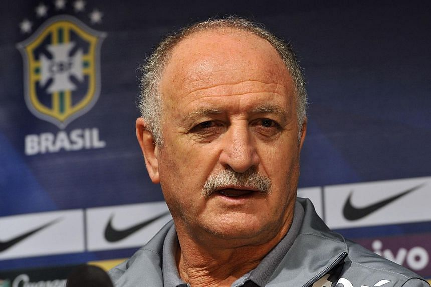 Brazilian football team coach Luiz Felipe Scolari speaks during a press conference after a training session ahead of a friendly football match with South Korea in Seoul on Oct 11, 2013. Mr Scolari would rather play Spain or the Netherlands if th