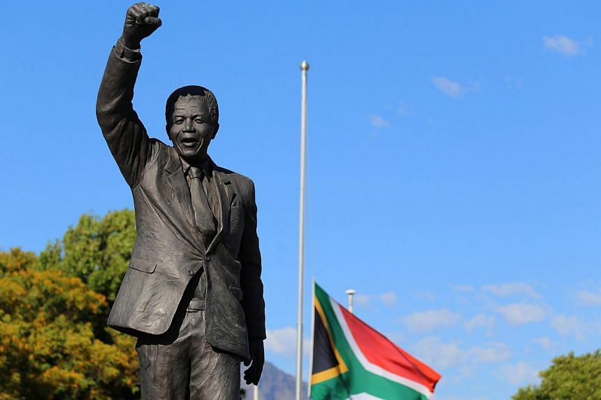 A statue of the late former South African president, Mr Nelson Mandela is seen outside the Victor Verster Prison in Paarl, Western Cape, on Dec 9, 2013.The presidents of the United States and Cuba will share a rare joint stage on Tuesday as wor