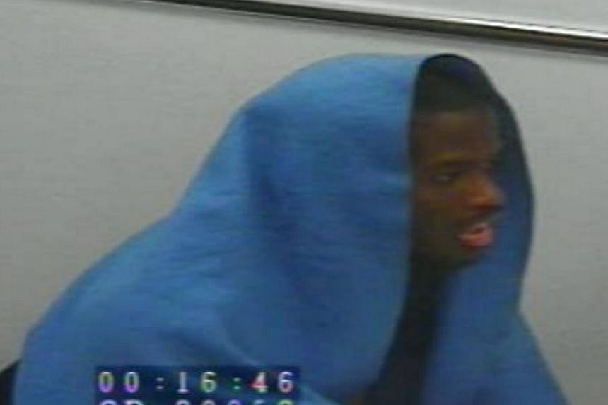 Michael Adebolajo is seen during a police interview in this undated still image taken from CCTV footage, released by the court during the Lee Rigby murder trial at the Old Bailey, and received via the Metropolitan Police, in London, on Dec 4, 2013.&n