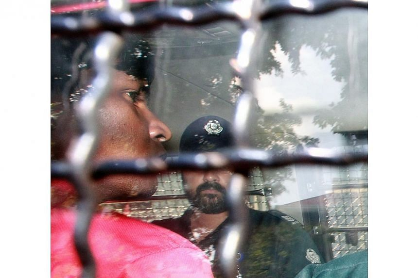 The South Asian rioters arrested for the fracas that happened on Sunday night arrive at the Subordinate Courts, on Dec 10, 2013, to be charged for vandalism and rioting with a deadly weapon. -- ST PHOTO: NEO XIAOBIN
