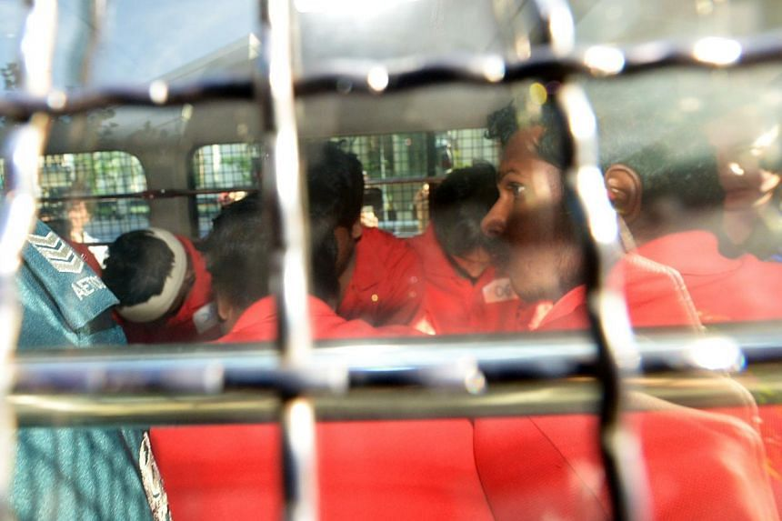 The South Asian rioters arrested for the fracas that happened on Sunday night arrive at the Subordinate Courts, on Dec 10, 2013, to be charged for vandalism and rioting with a deadly weapon. -- ST PHOTO: JAMIE KOH