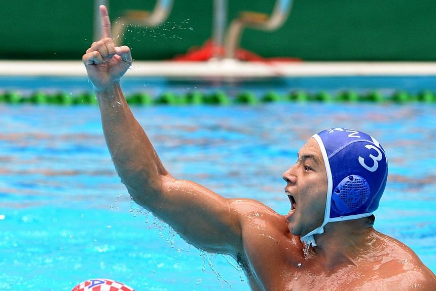 Singapore's Loh Zhi Zhi reacts after scoring. Singapore's water polo team beat hosts Myanmar 21-13 for its 25th successive SEA Games crown. -- ST FILE PHOTO: LIM SIN THAI