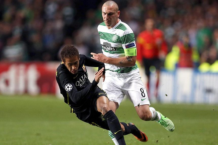Barcelona's Brazilian striker Neymar (left) under challenge from Celtic's Scottish their Champions League Group H football match at Celtic Park in Glasgow on Oct 1, 2012. Barcelona welcome Celtic to the Camp Nou for their second clash in the group st