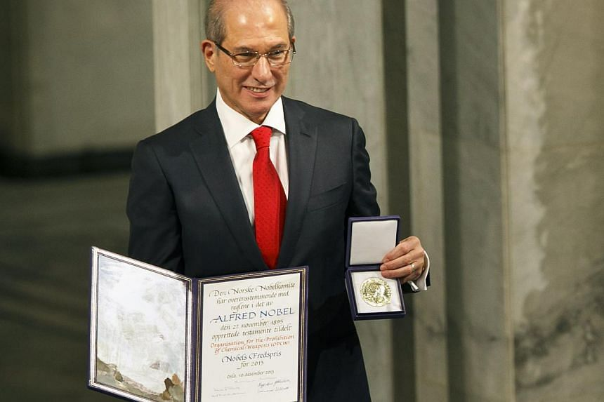 Ahmet Uzumcu, Director General of the Organisation for the Prohibiton of Chemical Weapons (OPCW), poses after being awarded the 2013 Peace Nobel Prize at the Oslo City Hall on Dec 10, 2013. -- PHOTO: AFP