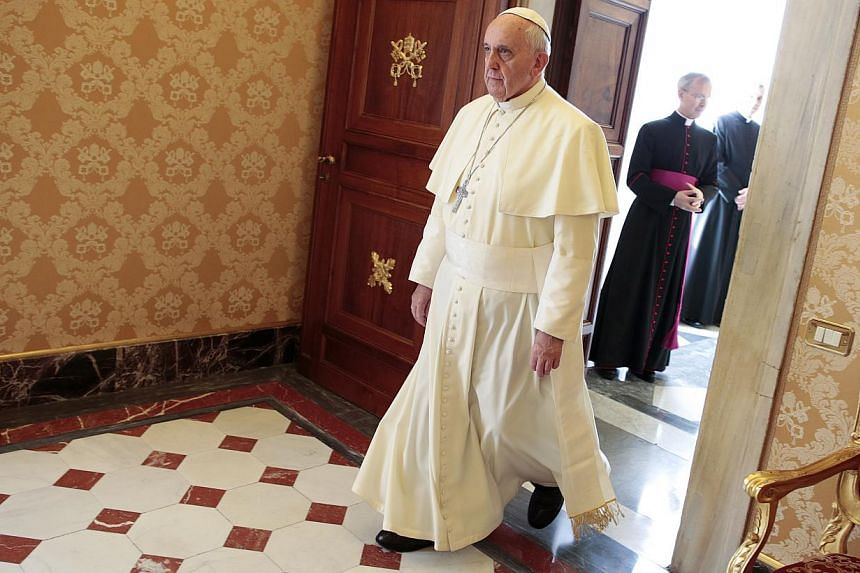 """Pope Francis denounced the """"global scandal"""" of hunger on Dec 9, 2013, calling for an international """"wave of prayer"""" to bring attention to the plight of the needy and homeless. -- PHOTO: AP"""