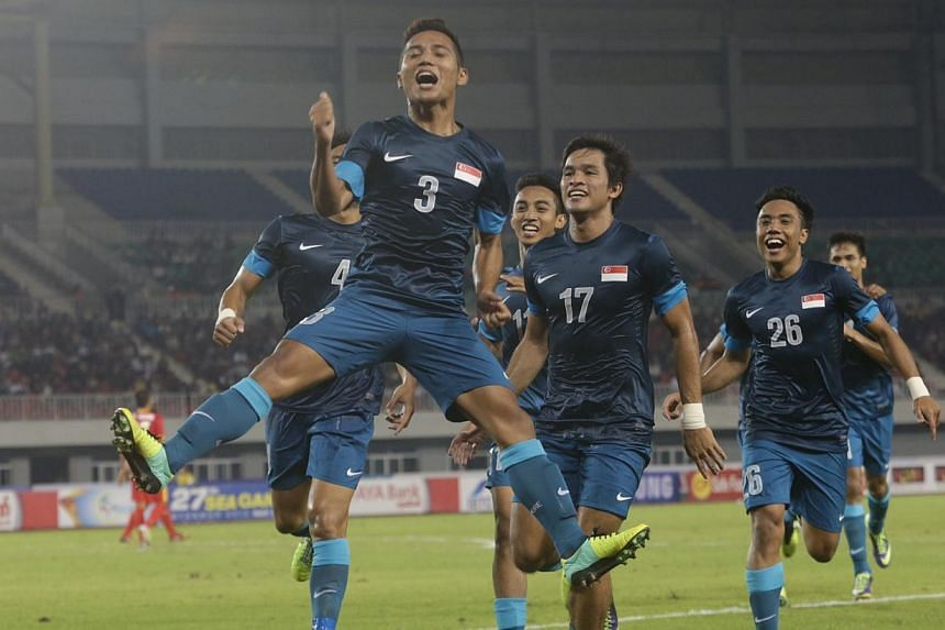 Singapore's Sahil Suhaimi (#3) celebrates after scoring a goal in the men's football competition of the 27th SEA Games in Naypyidaw's Zeyar Thiri Stadium, Myanmar, on Dec 10 2013. Singapore won the match 1-0. -- ST PHOTO: KEVIN LIM