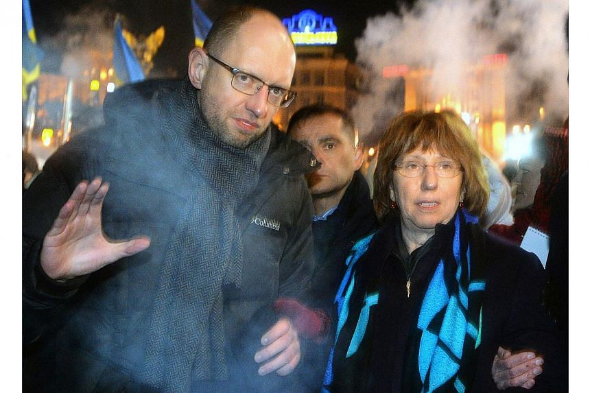 Ukrainian opposition leader Arseniy Yatsenyuk (left) and high representative of the union for foreign affairs and security policy for the European Union Catherine Ashton visiting a protesters' camp on the Independence Square in Kiev on Dec 10, 2013.