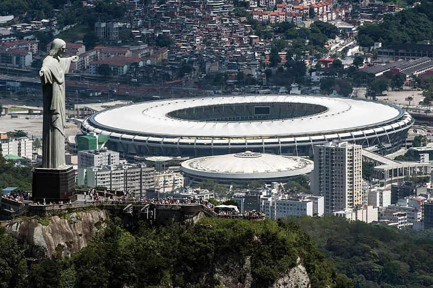 An aerial view of the Christ the Redeemer statue atop Corcovado Hill and the Mario Filho (Maracana) stadium in Rio de Janeiro, Brazil, on Dec 3, 2013.Organisers of the 2016 Rio de Janeiro Olympics have no time to lose with the International Oly