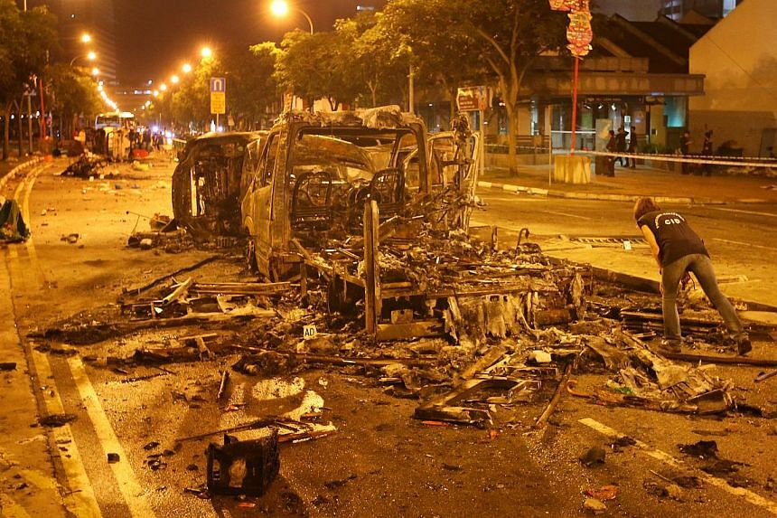 The aftermath of the Little India riot on Dec 09, 2013. Three more Indian nationals, arrested in connection with Sunday's riot in Little India, are due to appear in court on Wednesday afternoon to face rioting charges.-- TNP FILE PHOTO:GA