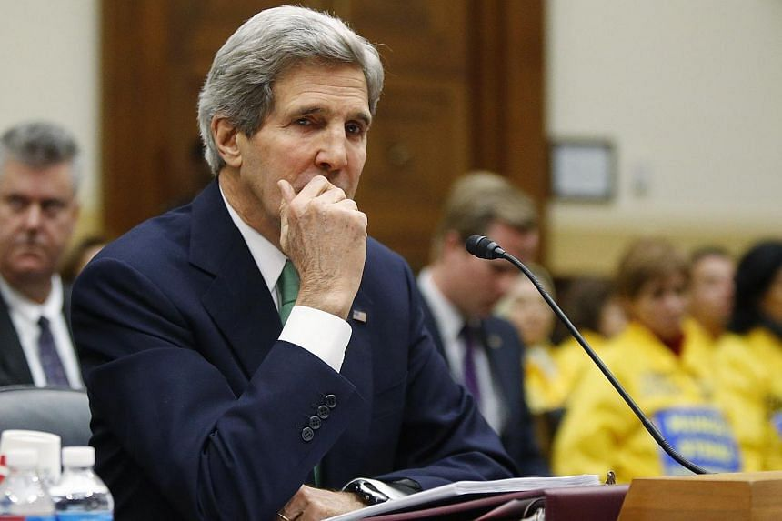 US Secretary of State John Kerry waiting to testify on the interim agreement over Iran's nuclear programme before the House Foreign Affairs Committee on Capitol Hill in Washington on December 10, 2013. MrKerry appealed to sceptical US lawmakers