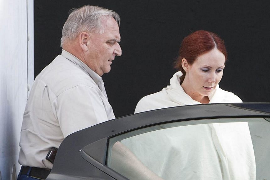 Shannon Richardson is placed into a Titus County Sheriff's car after an initial appearance at the federal building Texarkana, Texas, on June 7, 2013. Richardson, a former actress, pleaded guilty on Dec 10, 2013, to sending ricin-laced letters to Pres