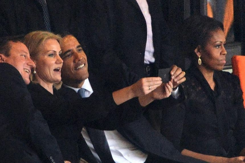 US President Barack Obama (second from right) and British Prime Minister David Cameron (left) pose for a picture with Denmark's Prime Minister Helle Thorning Schmidt (second from left) next to US First Lady Michelle Obama during the memorial service