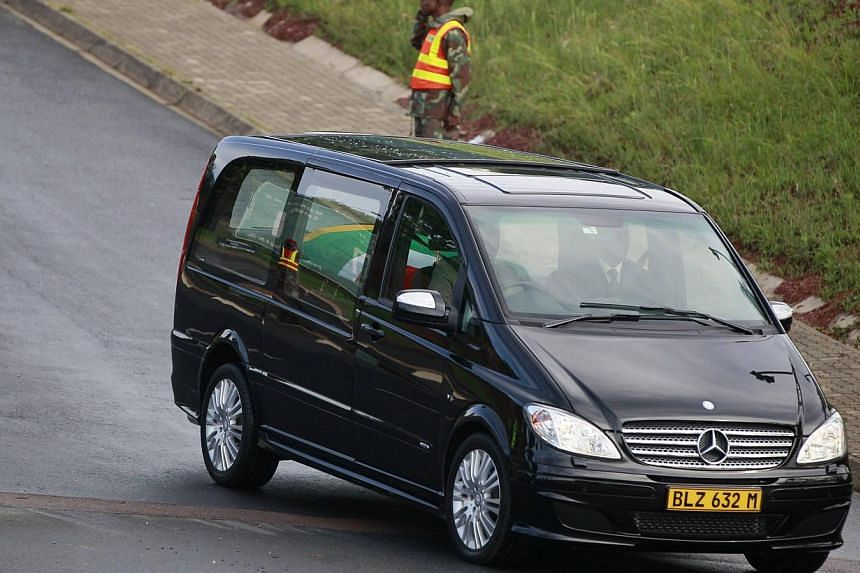 The funeral cortege carrying the coffin of former South African President Nelson Mandela leaves the Military Hospital on the outskirts of Pretoria on Dec 11, 2013, on its way to the Union Buildings. -- PHOTO: REUTERS