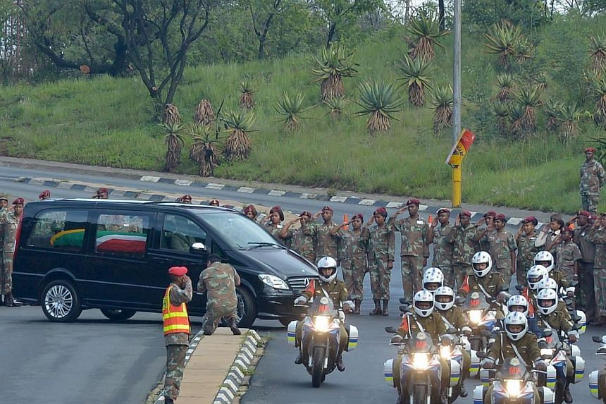 The funeral cortege of former South African President Nelson Mandela leaves the Military Hospital in Pretoria on Dec 11, 2013. -- PHOTO: AFP