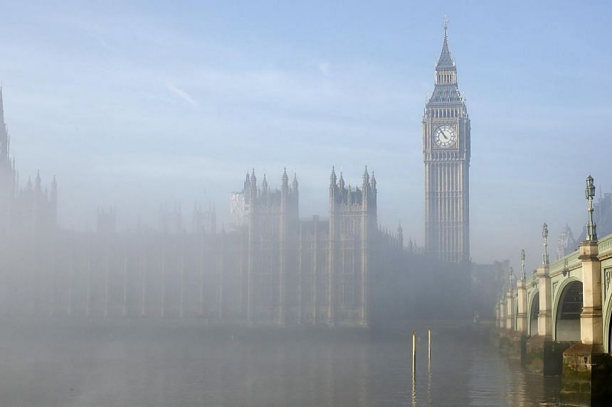 Fog clears around the Houses of Parliament in central London on Wednesday, Dec 11, 2013. -- PHOTO: REUTERSon Wednesday, Dec 11, 2013. -- PHOTO: REUTERS