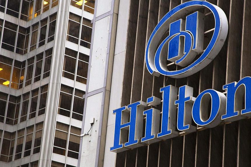 An exterior shot of the Hilton Midtown in New York in this June 7, 2013, file photo. Hilton Worldwide Inc, the world's largest hotel operator, raised roughly US$2.26 billion (S$2.82 billion) in its initial public offering on Wednesday after pric