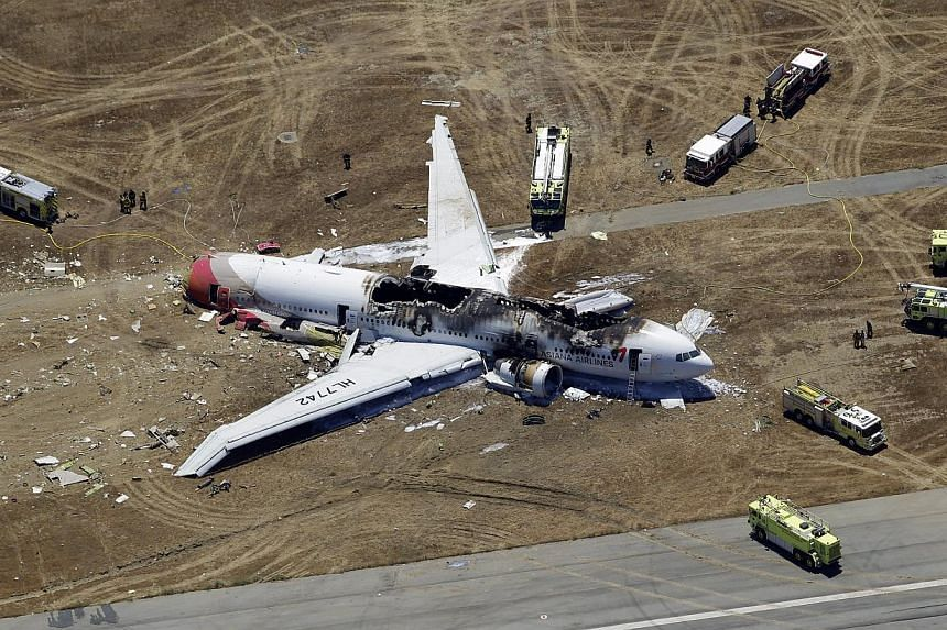 The wreckage of the Asiana Flight 214 airplane is seen after it crashed at the San Francisco International Airport in San Francisco, on July 6, 2013.The pilot flying the Asiana Airlines jet that crashed in San Francisco, killing three people, w