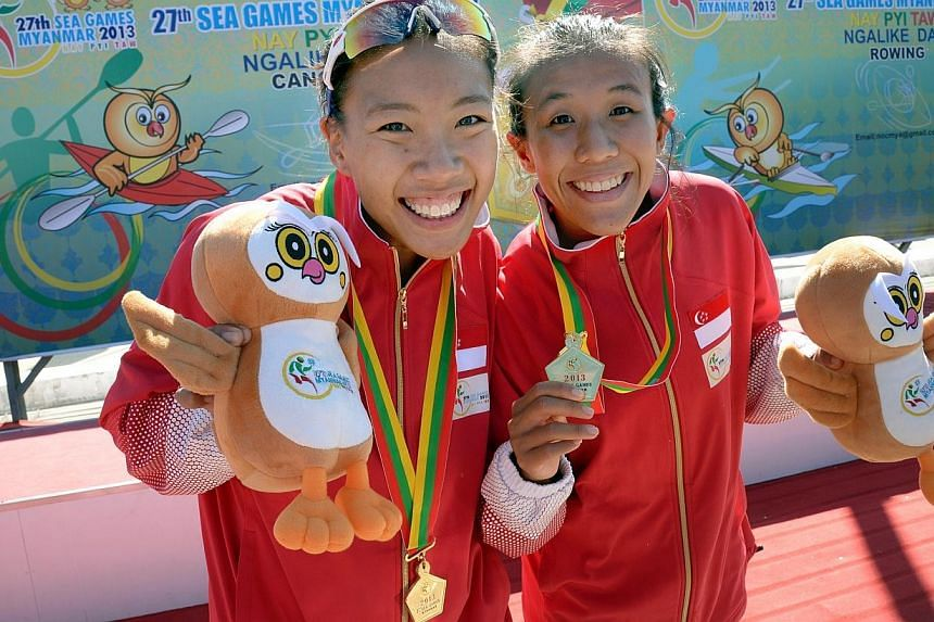 Stephenie Chen (left) and Suzanne Seah won gold in the women's K2 500m event at the Ngalike Dam, Naypyitaw, Myanmar on Thursday, Dec 12, 2013. -- ST PHOTO: LIM SIN THAI