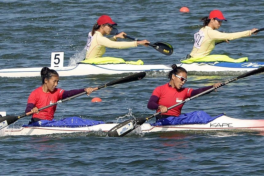 Stephenie Chen (foreground, left) and Suzanne Seah (foreground, right) won gold in the women's K2 500m event at the Ngalike Dam, Naypyitaw, Myanmar on Thursday, Dec 12, 2013. -- ST PHOTO: LIM SIN THAI