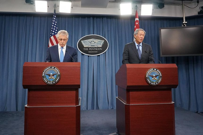 Defence Minister Ng Eng Hen (right) and his American counterpart Chuck Hagel have reiterated their commitment to promoting stability in the region, adding that they saw dialogue as a critical part of the solution. -- ST PHOTO: MELISSA SIM