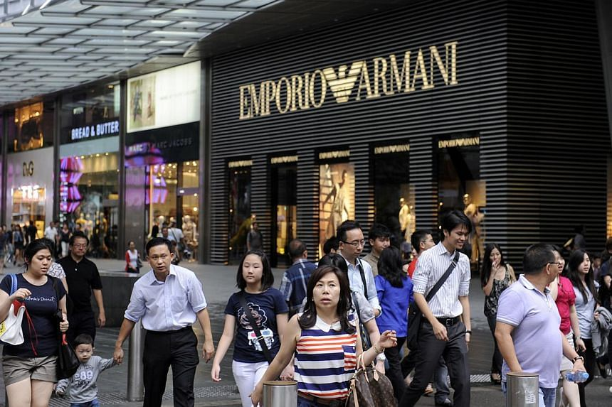 Shoppers along Orchard Road. Retail sales fell a sharp 9.4 per cent in October compared with a year ago, due to lower motor vehicles sales. If the effect of motor vehicles sales was excluded, retail sales went down by only 0.9 per cent. -- ST FILE PH