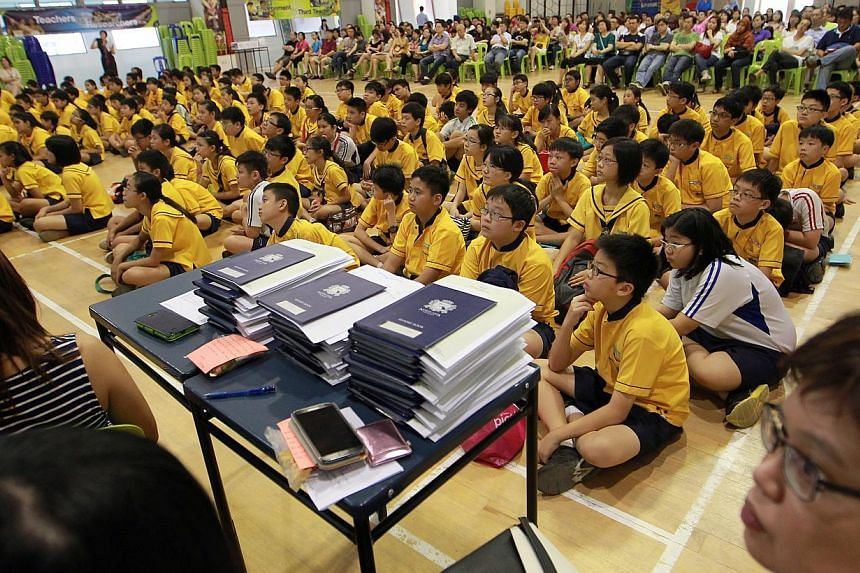 North Vista Primary's Primary 6 pupils await their PSLE results at the school hall on Nov 22, 2013. The Secondary 1 posting results will be released on Dec 20 at 9am. -- ST PHOTO: NEO XIAOBIN