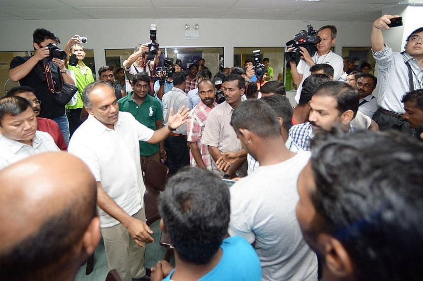 Law and Foreign Minister K. Shanmugam at a dialogue session with foreign workers at dormitory Kranji Lodge 1 on Dec 11, 2013. Mr Shanmugam on Thursday fended off allegations in foreign media reports that claimed Sunday's riot in Little India hap
