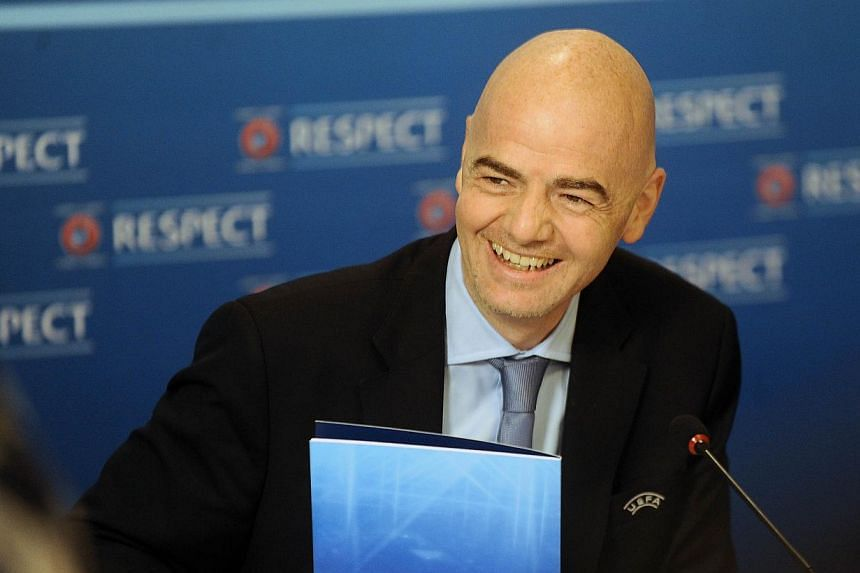 UEFA General Secretary Gianni Infantino smiles during a press conference on December 12, 2013 after the last UEFA Executive Committee meeting of the year in the northern Spanish Basque city of Bilbao.UEFA wants consistent sanctions against matc