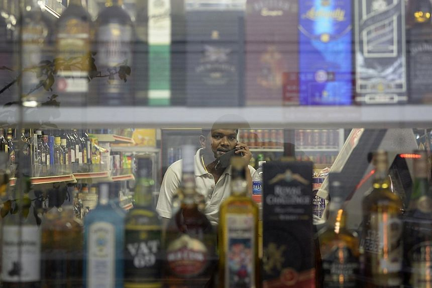Bottles of alcohol are displayed in a store at Little India. Those heading to Little India this weekend will not be able to buy alcohol or drink it in public areas, with the police instituting the move after last Sunday's incident.-- ST PHOTO:&