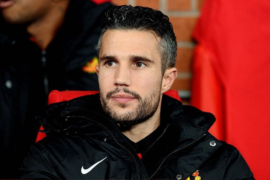 Manchester United's Dutch striker Robin van Persie sits on the bench before his side's Uefa Champions League match against Shakhtar Donetsk at Old Trafford on Dec 10, 2013. United received another setback on Friday when manager David Moyes revealed t