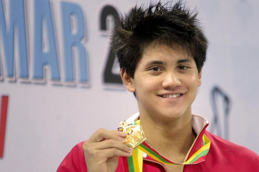 Joseph Schooling with the gold medal from the men's 200m individual medley in the 27th SEA Games in Naypyidaw's Wunna Theikdi Swimming Complex, Myanmar, on Friday, Dec 13, 2013.Schooling won his first individual gold medal of the SEA Games in N