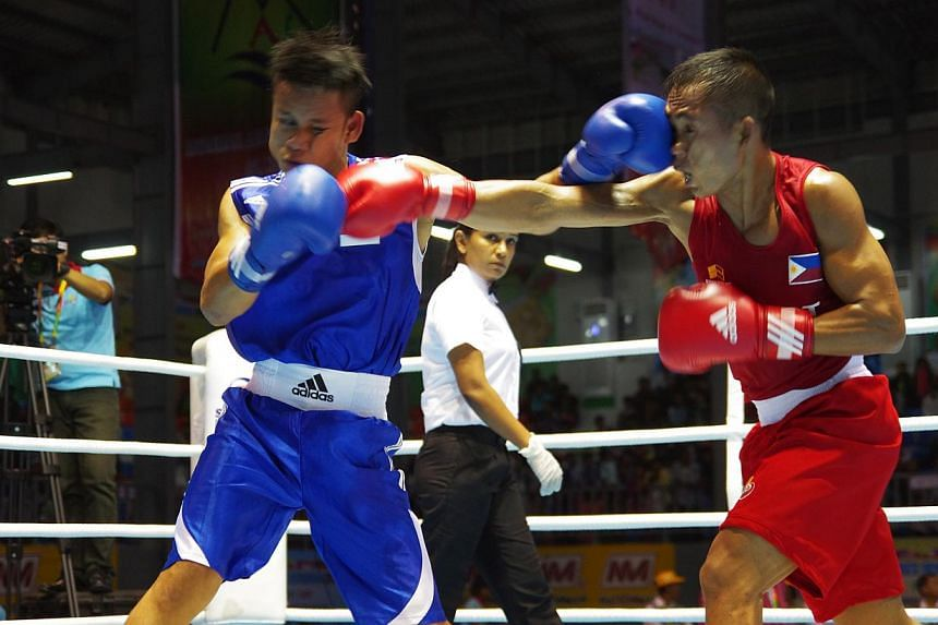 Singapore's Muhamad Ridhwan Ahmad (left) in action against the Philippines' Junel Cantancio in their lightweight (60kg) semi-final bout at the SEA Games in Myanmar. Singapore earned two bronze medals in boxing from Ridhwan and Muhammad Solihin Nordin