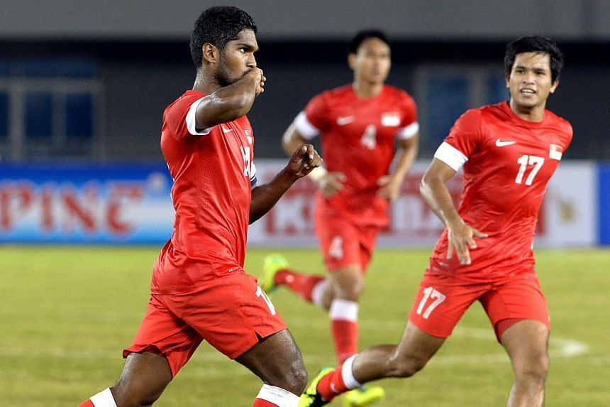 Singapore's Hariss Harun (left) celebrates his goal during their27th SEA Games football match against Bruneiat the Zeyar Thiri Football Stadium in Naypyitaw, Myanmar on Friday, Dec 13, 2013.Singapore continued their unbeaten start i